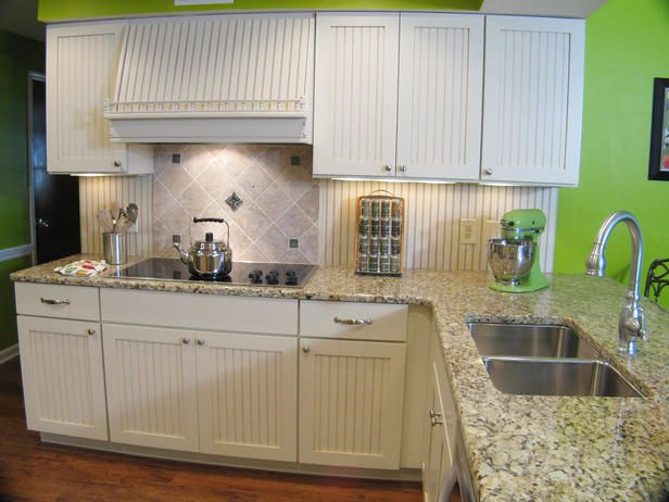 ... routed detail open grained wood that has a range in color of white  Beadboard cabinets in simple Shaker