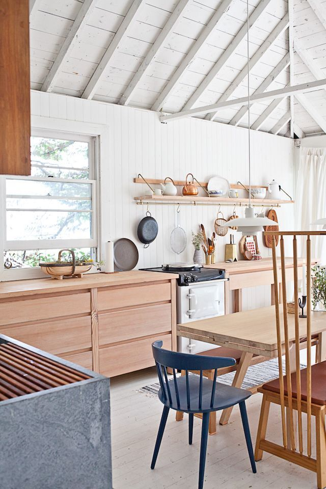 An idyllic white and wood Scandinavian style cabin