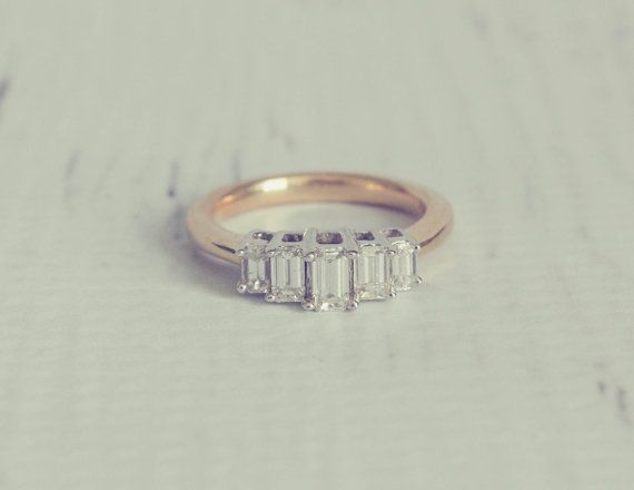 1960's Style Baguette Diamond Engagement Ring Almost perfect for my 15 yr anniversary. I want 4 baguettes though..~kk