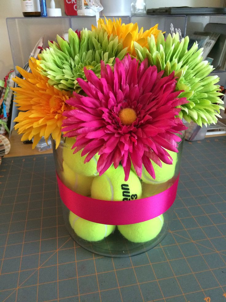 Coach's gift--tennis ball vase with silk flowers.