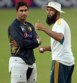 Nasir Jamshed and Hashim Amla have a chat during a nets session, Dubai, November 3, 2013