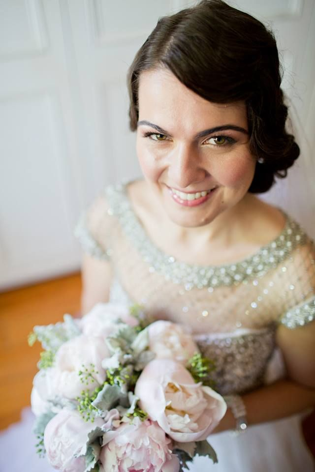 Beautiful bride with her Peonies bouquet