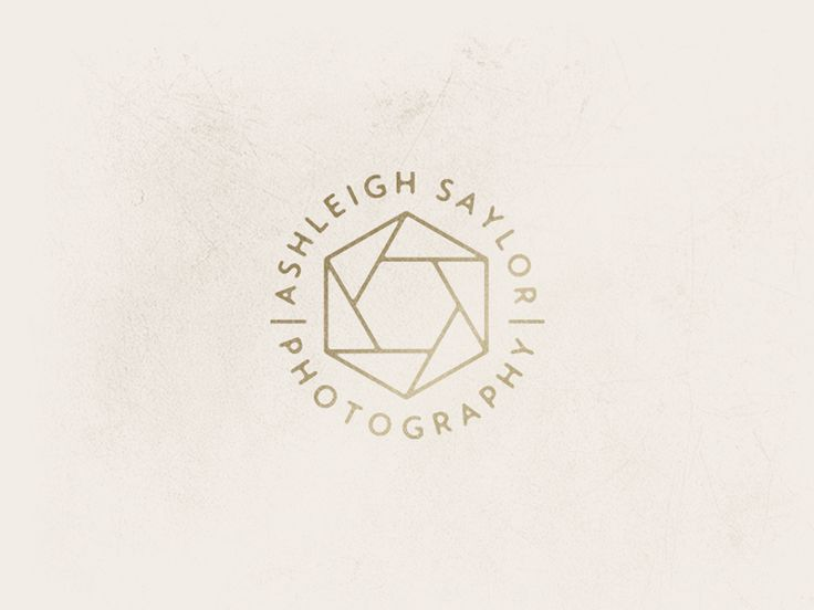 Noodling around with some ideas for a photographer's branding. I was going for a diamond / camera shutter mix.