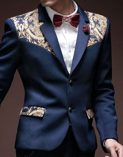 Can the floral paisley trend get more awesome? This navy blue blazer with a touch of golden floral creativity along the shoulder, is one stylish blazer to pay attention to!