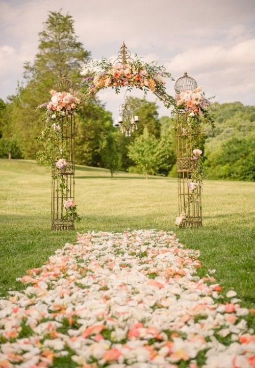great ideas for spring weddings, floral aisle with a very romantic metal arch trimmed with flowers just beautiful, perfect for backyard, in the country anything outside.via:weddingomania/comments:walkingonsunshine:)