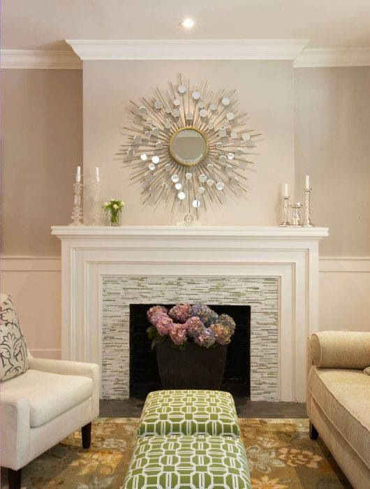 Build the wall out above the fireplace like this.  This style of mantel might be more appropriate given my bookshelf design?