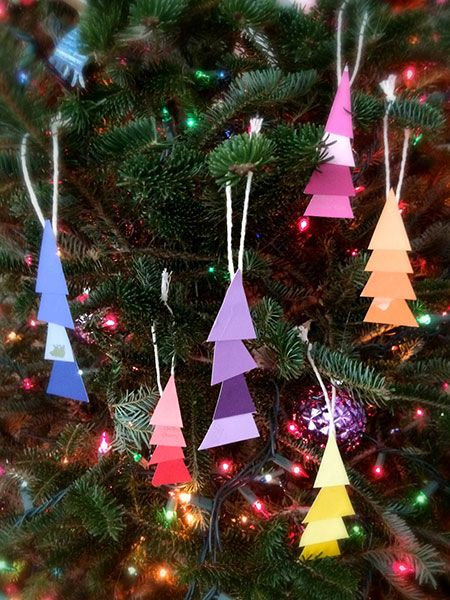 Pick up a few extra paint chips next time you're shopping for a project and recruit the kids to help create these cute ornaments. Get the instructions on @mollywag