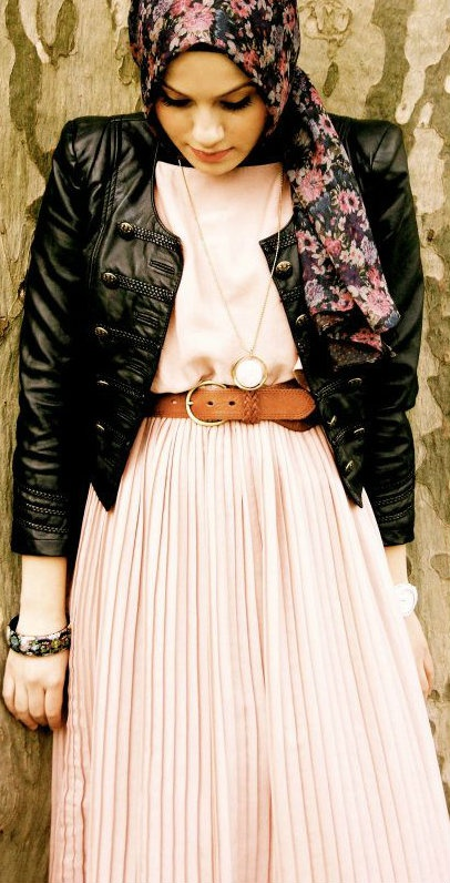 I like how she paired a girly pink dress and flower scarf with a leather jacket. It's random but it works.