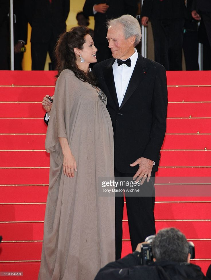 Actress Angelina Jolie and director Clint Eastwood attend the 'Changeling'…