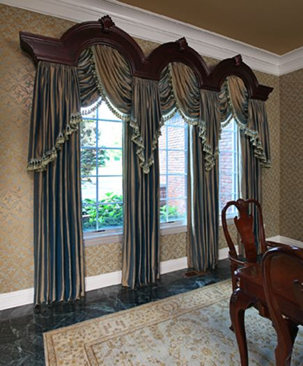 Unique half circle windows can create a challenge in designing drapery but this custom made wood cornice accentuates the architecture of the windows while supporting flowing silk from Fabricut and fancy trim from Kravet. Valerie Young Interiors Valerie L. Young - Lake Orion, MI