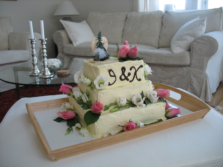 A wedding cake!  With fresh flowers and chocolate letters.