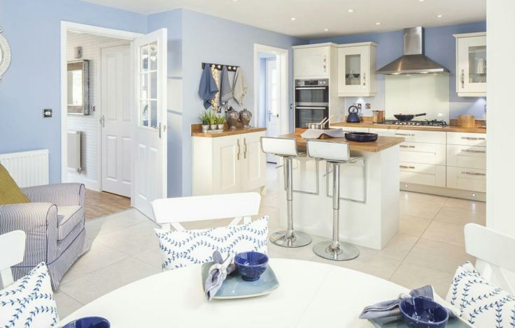 Coastal Theme Interior Designed Kitchen Dining Room With Small Island.  French Table And Chairs,