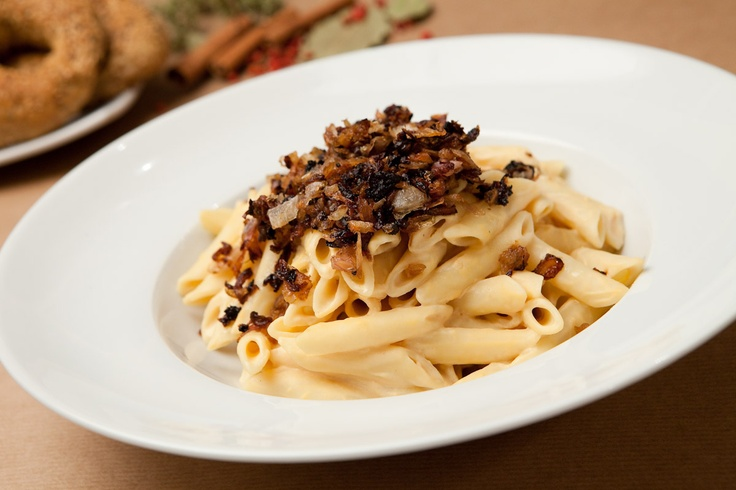 Penne with creamy goat cheese form Kassos island (Dodecanese) and caramelized onions in clarified butter