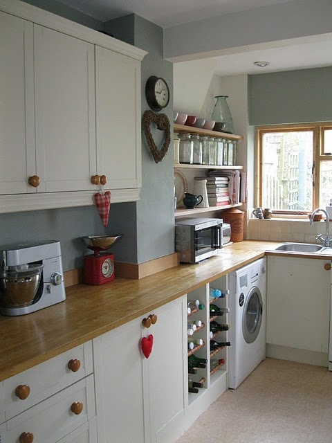 Modern country style - exchange the wooden knobs for glass ones.
