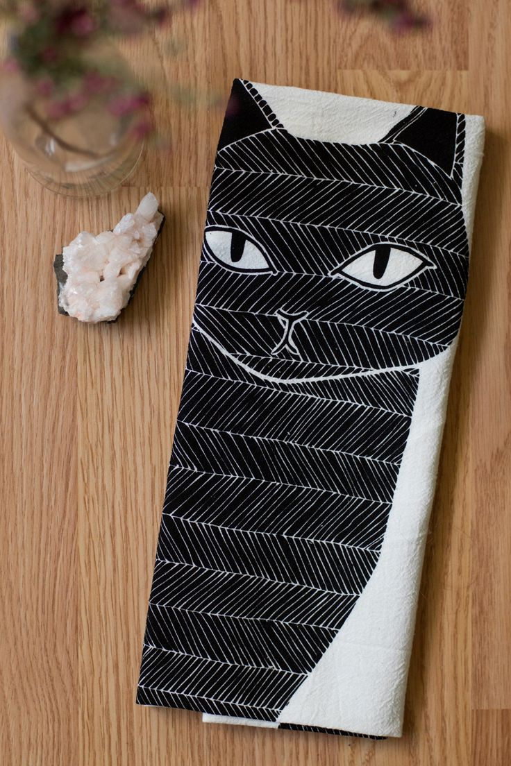 """Gingiber's Black Cat illustration, now on a handy tea towel! Approximately 26""""x27"""". - Professionally screen printed with water-based, eco-friendly black ink on 100% cotton. - Machine washable."""