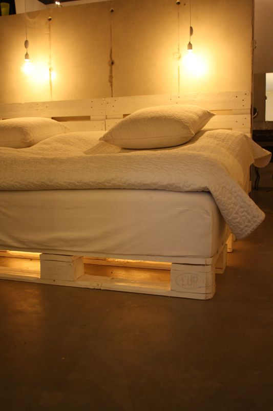 a platform bed and headboard with under bed lighting made