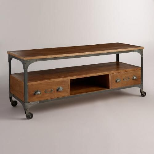Our media shelf gives your space a rustic, industrial feel with its mango wood surfaces, and metal accents like library-style drawer pulls and locking caster wheels. It offers plenty of storage space for all of your media components with two drawers, a cubby and a bottom shelf.