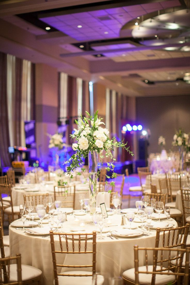 An elegant wedding reception at @HyattChicago in the Crystal Balroom. The only ballroom in Chicago located at street level, Crystal Ballroom features spectacular views of city lights and downtown landmarks. This dazzling event space boasts 19-foot-high windows with an impressive panorama of the river, the Tribune Tower and the Wrigley Building.