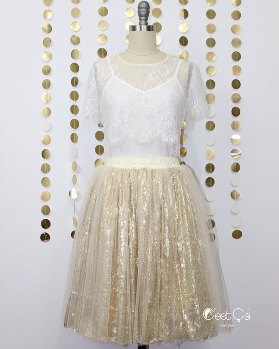 Looking for something sparkly golden? This sequin tulle skirt is for you! Perfect for birthday and bachelorette parties 🎉  - Sequin and tulle fabric - Fully lined - Petite midi length (19.5) - Flat stretchy waistband  HOW IT FITS:  Small - Stretchy waist 24-31 Medium - Stretchy waist 32-38 Large - Stretchy waist 39-44 Extra Large - Stretchy waist 45-52  IF YOU HAVE A SHORT DEADLINE, PLEASE INQUIRE ABOUT READY-TO-SHIP SKIRTS (!!! Please include your waist measurement or US dress size, your…