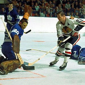 Stan Mikita thwarted by Terry Sawchuk of the Leafs