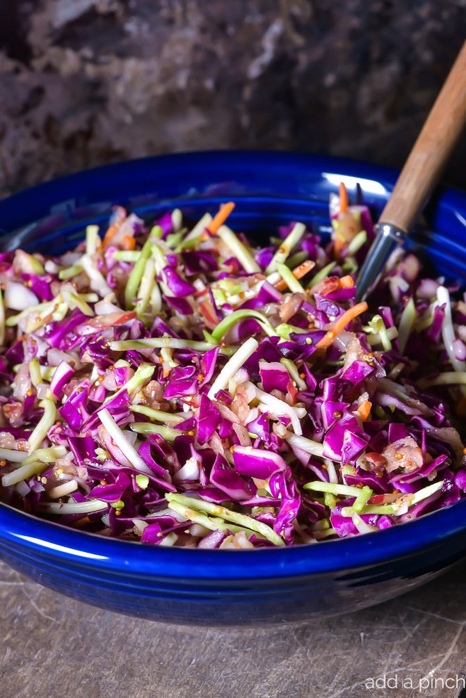Asian Slaw Recipe. This Asian slaw recipe is quick, easy and so full of flavor. Perfect for a weeknight side dish or even when entertaining! // addapinch.com