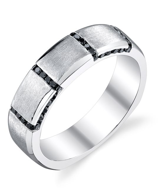 He'll love the drama of this satin finish band with black Diamonds set into a 14-karat white gold Men's Wedding Band from Mark Schneider Designs.