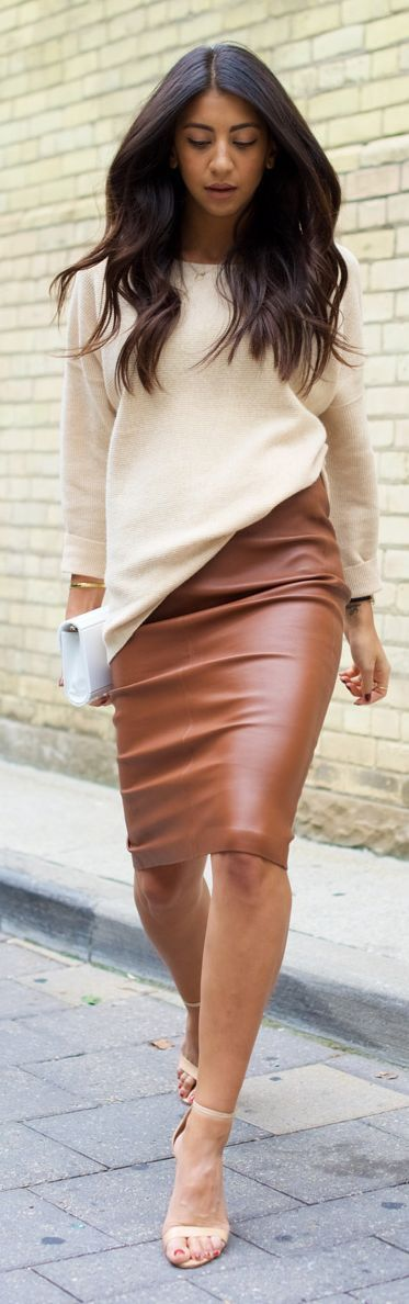 Cream asymetrical top paired with camel colored faux leather knee length skirt.