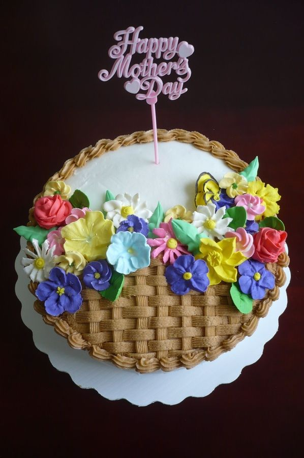 Fudge chocolate cake covered with buttercream. All flowers are done in royal icing.