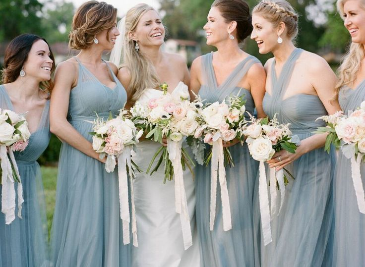 the bride and her bridesmaids share a fun moment before the ceremony! Bouquets wrapped and tied with beautiful silk ribbons from www.froufrouchic.com