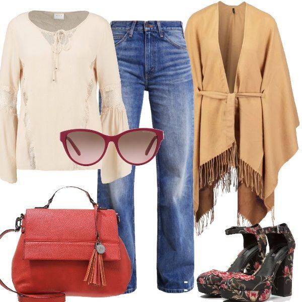 Jeans a zampa a vita alta per questo look, in abbinamento ho scelto una blusa in viscosa con inserti in pizzo e manica a campana. Come capospalla la mantella color cammello con frange e cintura da annodare in vita. Le scarpe sono le protagoniste in questo outfit con la loro fantasia floreale. La borsa a mano in ecopelle è rossa e per dare un tocco glam a questo stile ho scelto un paio di occhiali da sole. In questa stagione, per stare più caldi, consiglio un piumino cento grammi color avorio…