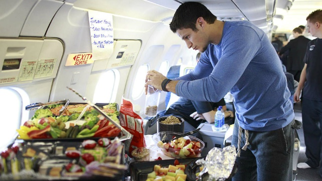 Kevin Bieksa picking some food on the plane. Vancouver Canucks <3