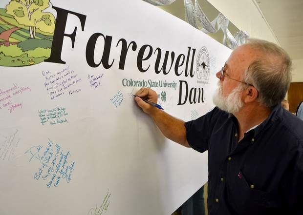 Journal/Sam Green  Les Rogers signs a retirement farewell banner for Colorado State University Extention Director Dan Fernandez on Wednesday in Dove Creek.