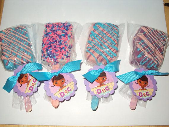 12 Doc McStuffins Inspired Rice Krispy Treat Pops with Doc McStuffins face tags and blue ribbon to match on Etsy, $16.25