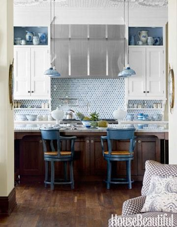 Blue penny tile and delft pottery lend a watery inluence to this kitchen with white cabinets and stainless steel hood. For custom cabinet ideas for your home see our gallery: www.custommade.com/search/home-garden/kitchen-bar/kitchen-storage-organization/