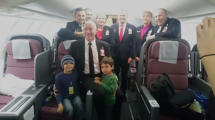 Captain Bryan Welch with some of the Qantas crew on board his final flight. (Karissa Welch)