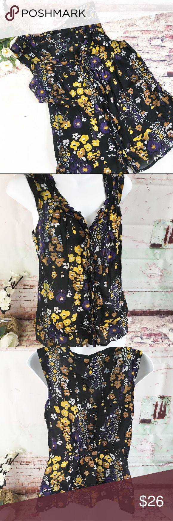 H&M Purple Floral Tie Top, Size 8 H&M Purple Floral Tie Top, Size 8.  Sleeveless, buttons down front with tie at top button.  LIKE NEW H&M Tops