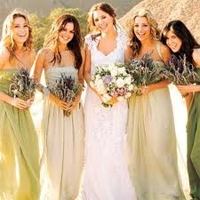 Soft greens in matte washed silk ... think sage, pistachio and olive. Bare shoulders on the bridesmaids, frilled neck on the bride, wild lavender bouquets. Fresh and pretty.