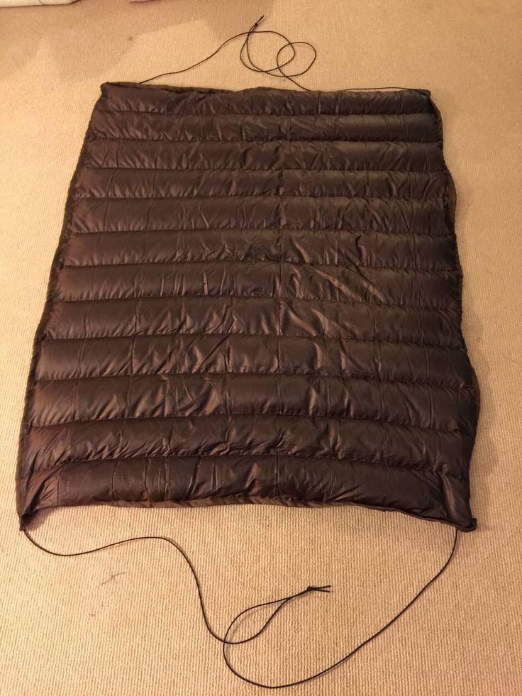Finished camping hammock underquilt with shock cords for suspension