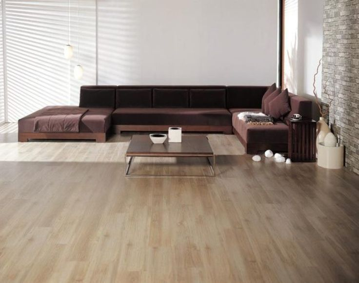 U Shaped Brown Velvet Extra Large Sectional Sofas With Sleeper And Cushions Added By Brown Glossy Wooden Table On Laminate Flooring