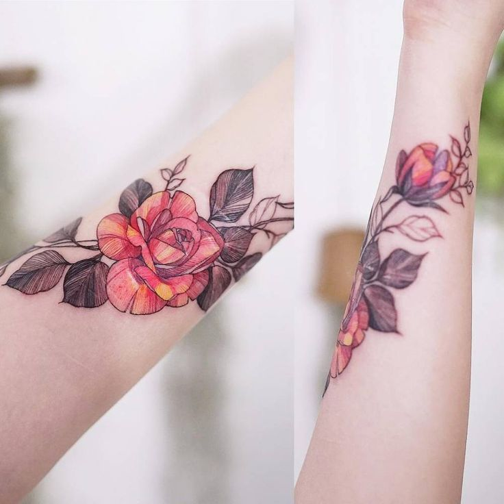 Scar cover red rose tattoo on the inner forearm.