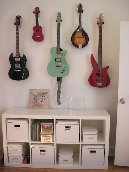 Hanging guitars on wall.