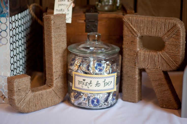 twine wrapped letters in the initials of the bride and groom for a rustic touch at a wedding - thereddirtbride.com - see more of this wedding here