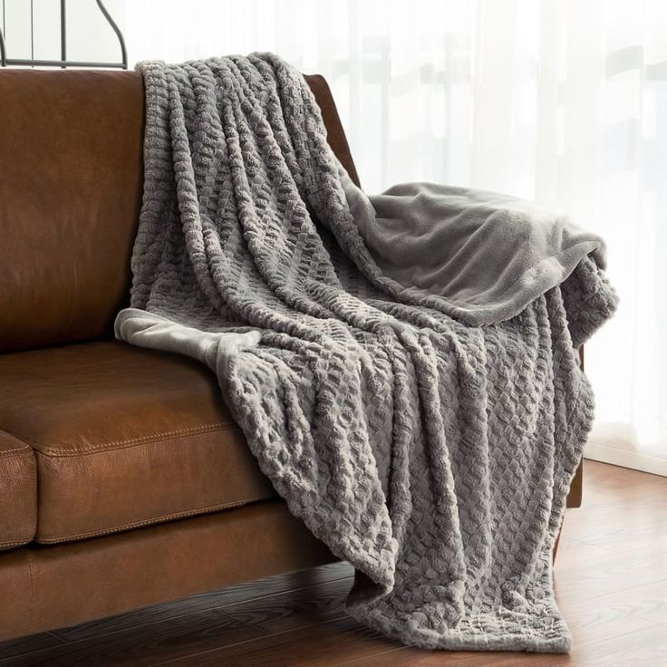 "Get it from Amazon for $24.99.Promising review: ""Softest blanket ever! So luxurious — I can't get over how super soft this thing is. I like the woven pattern look on the top side; it's really pretty draped over my recliner. The back is plain if that's the look you would rather have. The blanket keeps me nice and toasty; it isn't thin at all. It's well made, nice and square, and all the seams are sewn correctly. Easy to care for, too — just wash and dry and it's like brand new. Love this…"
