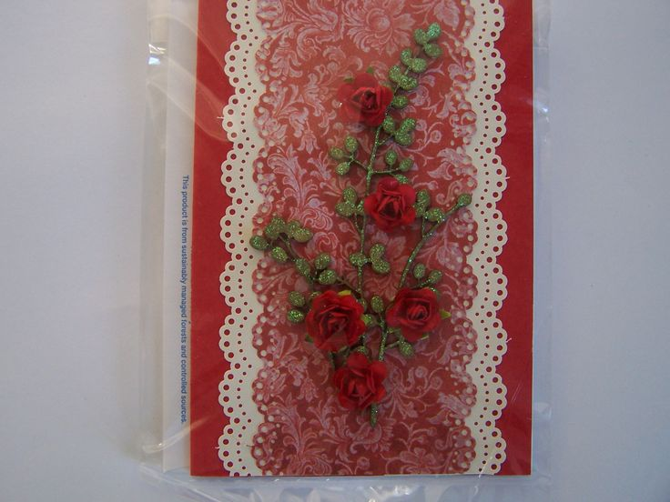 Gold spray with red roses