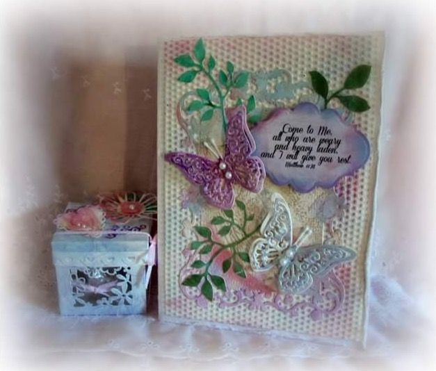 Made with starter kit dies and embossing folder from Sizzix Big Shot Plus. Spellbinders card creator die. Tim Holtz alterations garden greens. Papers painted with Martha Stewart pastel pearl craft paints. Made by Janice Woodard.