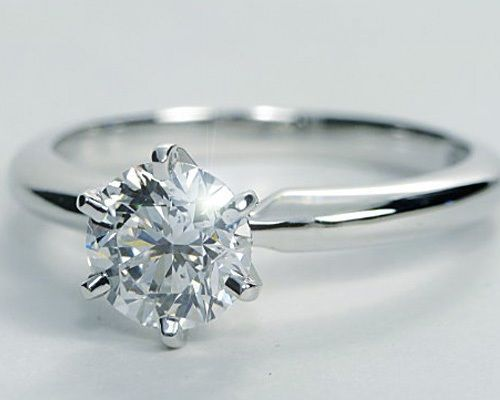 Single diamond engagement rings never go out of style! And at over 2 carats, this one will keep its shine forever.
