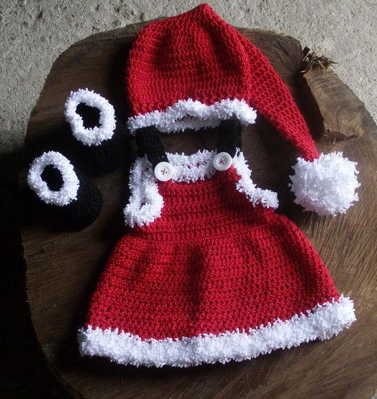 Conjunto confeccionado em crochê ( vestidinho,gorro e botinhas) detalhes - pompom,botões cor- vermelho/preto e branco tamanhos - RN , 1 a 3 , 3 a 6 / 6 a 9 meses R$ 99,90