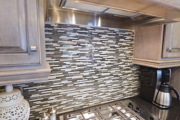 contemporary horizontal glass tile backsplash.   the anniversary