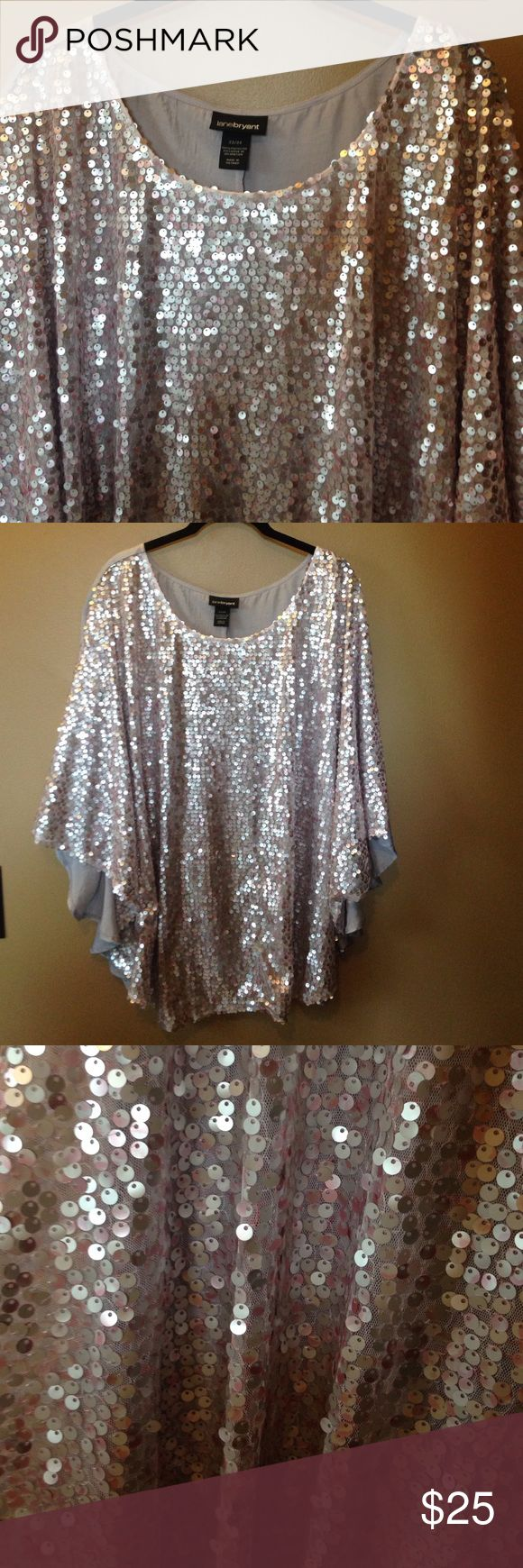 Lane Bryant Sequin Batwing Top You've found your holiday outfit! . Beautiful and comfortable.  Chiffon back, Batwing style, with beautiful sequined front.  The top photographs on the silver side but is more of a light lavender.  This is a reposh I bought this for myself to go with fun leggings but it was too big.  The Batwing style gives a nice oversized comfortable look.  I only tried it on.  It shows very little if any Wear!  Size 22/24 Lane Bryant Tops Blouses