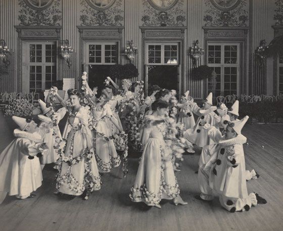The Gilded Age NYC, shown here: Debutantes and their Pierrot costumned partners, at the James Hazen Hyde Ball. One of the last Grand Balls of Gilded Age society c.1905.